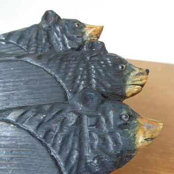 Hand carved wood black bear coasters with glass eyes