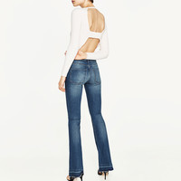 SKINNY FIT FLARED JEANS