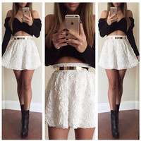 Black Long Sleeve Cropped Top and White Floral Mini Skirt