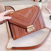 MK hot sale ladies gold button cashmere patchwork leather one-shoulder shopping bag