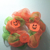 9 inch wreath. Deco mesh Halloween wreath made with orange and green with wooden pumpkins