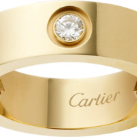 LOVE ring, 3 diamonds: LOVE ring, 18K yellow gold, set with 3 brilliant-cut diamonds totaling 0.22 carat.
