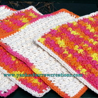 sunny and bright orange and yellow crochet dish cloths