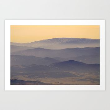 Sunset at the foggy mountains Art Print by Guido Montañés