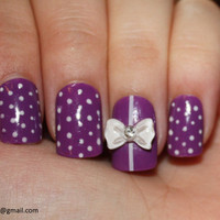 Purple Nails with polka dots and bows