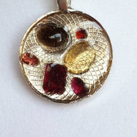 Gemstone pendant. Genuine amathyst, garnet and smokey quartz floating in resin. Handcrafted. Original and eclectic.