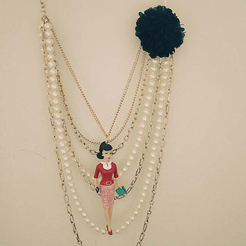 Barbie teacher in red layered necklace