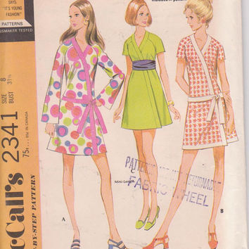 Vintage 1970s pattern for wrap mini dress with either dropped waist or obi tie long or short sleeves misses size 8 McCalls 2341 UNCUT