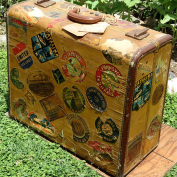 Old Suitcase Covered in Authentic Travel Stickers Well Traveled