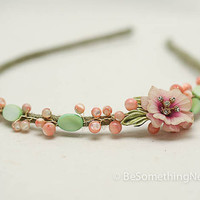 beaded headband with a vintage flower and beads in green and pink