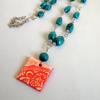 Turquoise Necklace with a Light Red Pendant made with Faux Ceramics Technique