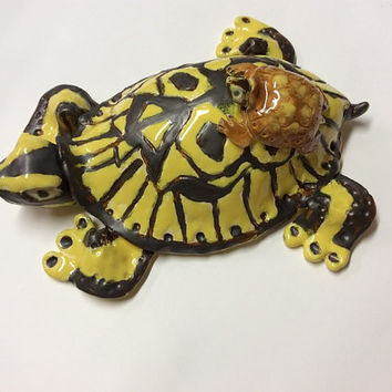 Handsculptured Box Turtle with Baby by Jaymi. bright yellow and dark brown with the baby in amber glaze.  Wall hanging or table display