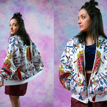 vtg 90's 80's white red blue gold pattern windbreaker, 1990s 1980s vintage athletic, tumblr, soft grunge fashion, vaporwave, urban aesthetic