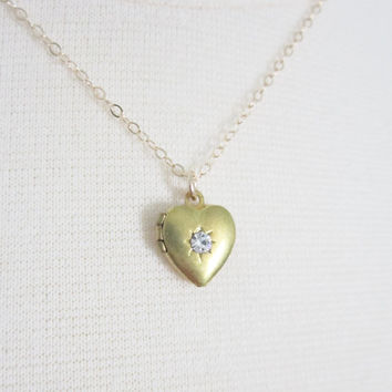 Tiny heart locket with crystal star on gold filled chain, delicate modern jewelry