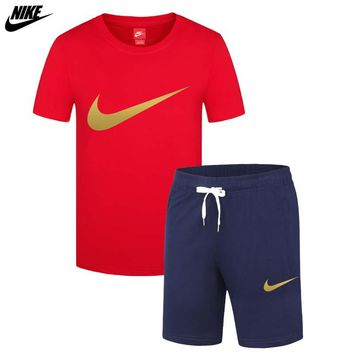 NIKE trend men's thin section sports breathable casual short-sleeved shorts running two-piece red
