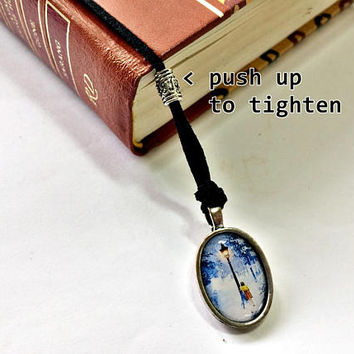 Girl By The Lamp Post Bookmark: suede cord with resin pendant (adjustable & no-slip)