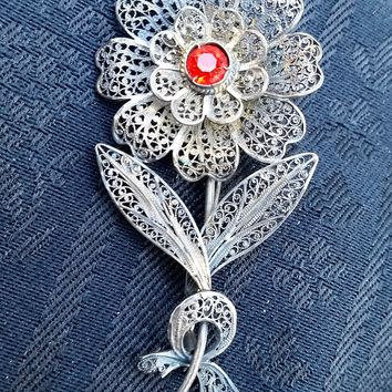Cannetille filigree Sterling Silver filigree flower with red accent rhinestone Brooch Edwardian Victorian