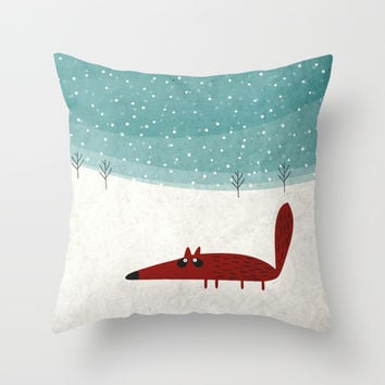 the fox in the snow Throw Pillow by Fuzzorama