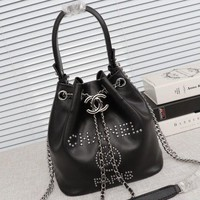 Chanel cow leather rivet bucket bag with arm across arm