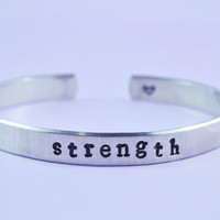 strength - Cuff Bracelet, Hand Stamped, Pure Aluminum, Shiny, Skinny, Adjustable, Newsprint Font