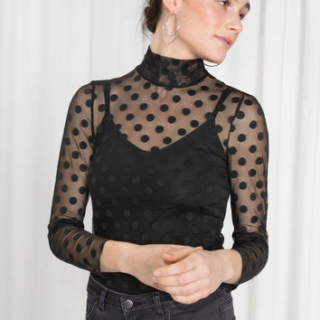 Sheer Turtleneck Blouse