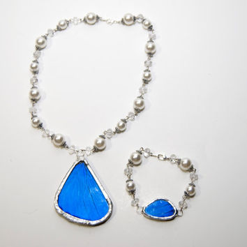 FREE SHIPPING   Real Blue Morpho Butterfly Wings Encased in Hand Cut Glass and Soldered Matching Necklace and Bracelet