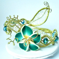 Goldplated flower cuff bracelet with large green plumeria wire wrapped beaded