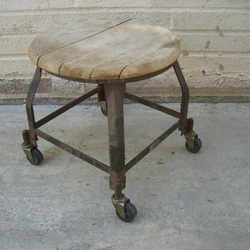 Vintage, Rustic, industrial, 1940's, steel stool on wheels with a wooden seat.