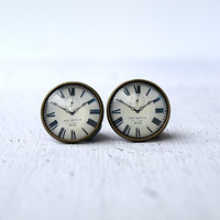 Clock studs earrings.