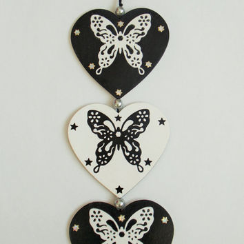 Hanging heart decoration with die cut butterflies, black embroidery thread and beads. Reversible black and white hanging decoration.