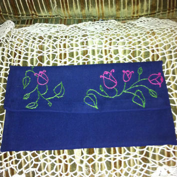 Clutch Blue with Embroidery Flowers on the front flap.