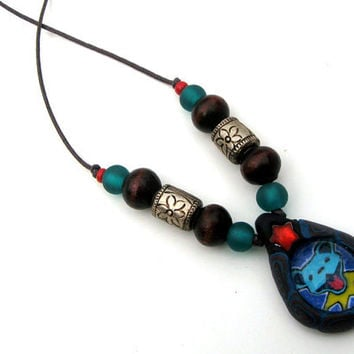 Grateful Dead pendant with dancing bear, millefiori patterns made from polymer clay with glass addition, on cord with mixed beads