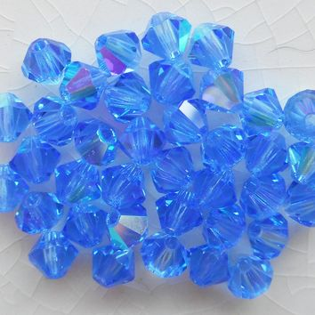 Lot of 24 4mm Sapphire Blue AB Czech Preciosa Crystal bicone beads, faceted glass blue AB bicones C5601