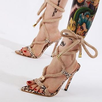 Fashionable retro serpentine pointed strap-on slim super high heels