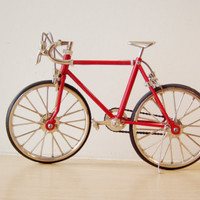 Bright red racing bike miniature, retro collectibl