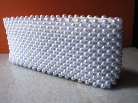 A beaded clutch made of 8mm pearls by Mahalasa on Etsy