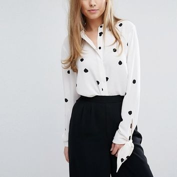 Warehouse Polka Dot Tie Sleeve Blouse at asos.com