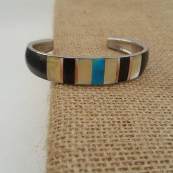 Pretty torqouise, mother of pearl , pink and black cuff.