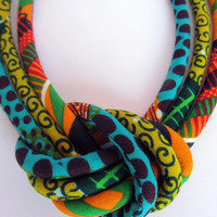 Fabric bib necklace, african wax print with a central knot orange,green,yellow