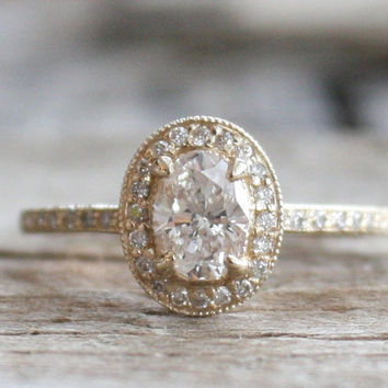 GIA Certified Oval Diamond Halo Ring in 14K Yellow Gold
