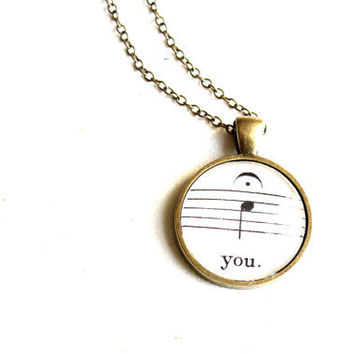 "Unique sheet music pendant on chain.  Music note with fermata word ""you"".  Modern black and white accessory for women"
