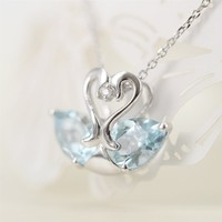 Magic Pieces Sterling Silver Love Swans Pendant with Faceted Pear Shape Blue Topaz and CZ