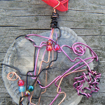 Beach Jewels. Wire Wrapped  Glass Pendant. Sea Glass Bottle Bottom wrapped in wire with glass beads.ON SALE WAS 15.00