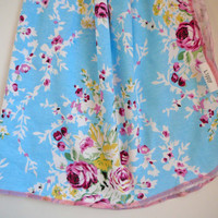 Floral baby blanket. Size 31 by 40 inches. Bright blue floral print with pink edging. Darling for baby girl.