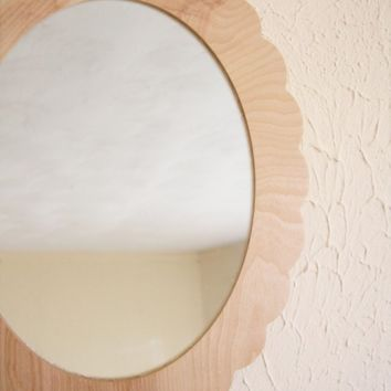 scalloped mirror in natural wood