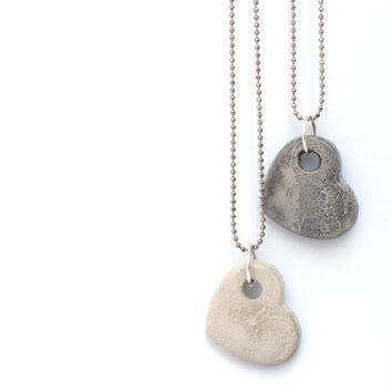 Two concrete hearts necklaces. One for her & one for him. Happy Valentine's Day presents.