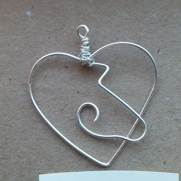 Wire wrapped horse heart pendant, silver artistic wire. Handcrafted.