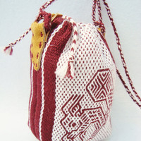 Small handwoven pouch made of purple wool with original squirrel design