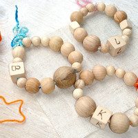 Baby wooden teether Initials Wooden ring Wood burned  Teething toy Blue orange brown Choose a letter
