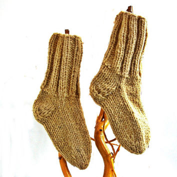 Hand knitted non dyed raw color children wool socks. 100% wool yarn.